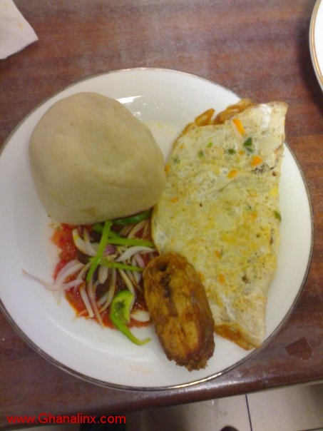 banku, fish and some fried eggs