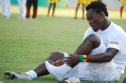 Essien sitting on pitch
