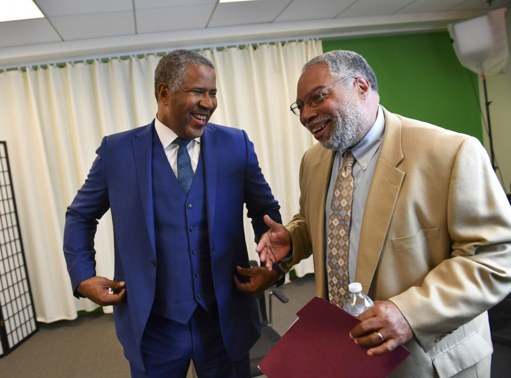 "Robert Smith, left, has a quick word with Lonnie G. Bunch III, director of the National Museum of African American History and Culture. Smith's donation, Bunch said, ""helps us jump full speed ahead as a digital museum."" (Ricky Carioti/The Washington Post)"